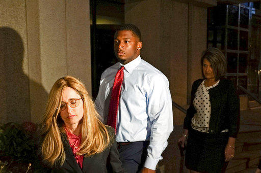 In this Sept. 14, 2017, file photo, Ma'Lik Richmond, center, of Steubenville, Ohio, and his attorney Susan Stone, left, walk out of U.S. District Court in Youngstown, Ohio.