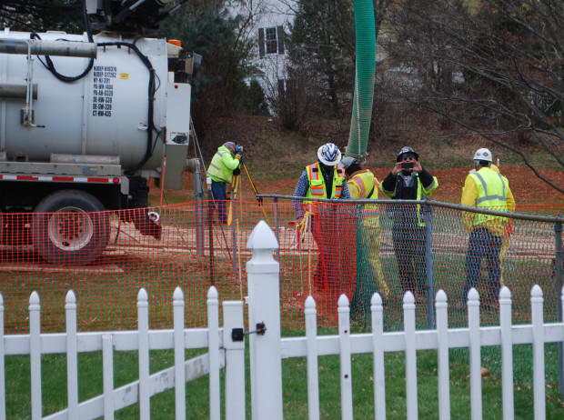 Workers and contractors for Sunoco Pipeline investigate geological conditions behind homes at Lisa Drive in West Whiteland Township.
