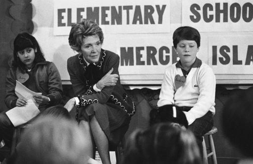 "In this Feb. 14, 1984 file photo, former first lady Nancy Reagan participates in a drug education class. She was prominent in the ""Just Say No"" campaign that was part of the War on Drugs and encouraged abstinence as a form of drug control."