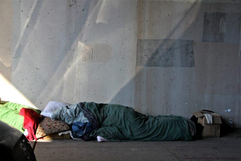 A homeless person takes shelter under an overpass on North 5th Street in Philadelphia.