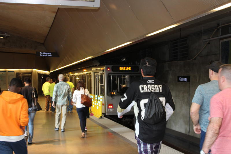 Passengers walk toward a train at the Gateway Station.