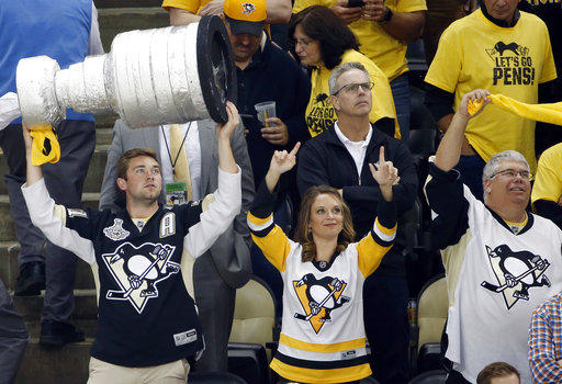 a6f098822 Pittsburgh Penguins fans cheer during the third period in Game 5 of the NHL  hockey Stanley Cup Final between the Penguins and Nashville Predators