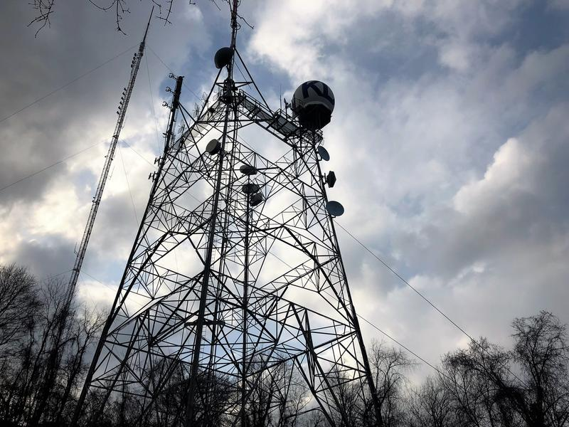A radio tower for WPNT-FM Pittsburgh towers over the Perry North neighborhood on Tuesday, April 10, 2018. The hill under the tower is the site of the highest point in Pittsburgh, at 1,371 feet above sea level.