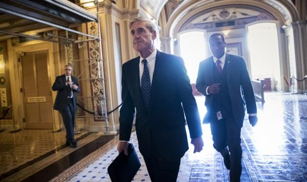 In this Wednesday, June 21, 2017 photo, Special Counsel Robert Mueller leaves the Capitol after a closed-door meeting with members of the Senate Judiciary Committee.
