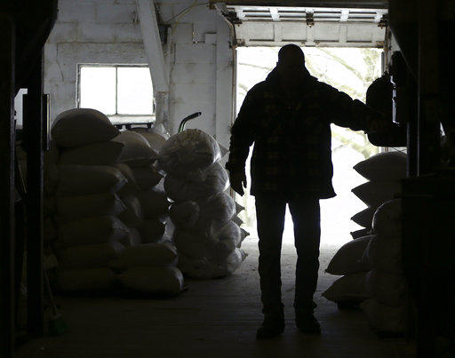 Richard McNulty of Sankey's Feed Mill walks through stacks of feed at his store in Volant on Thursday, April 5, 2018. The latest PNC Economic Outlook survey suggests small businesses across PA are optimistic, despite outside influencers like tariffs.