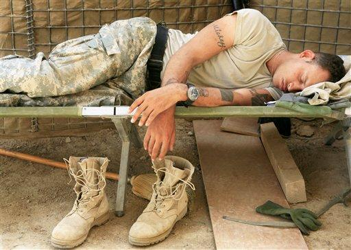 U.S. Army Stg. Michael Proctor, 28, from Riverside, Calif., of Bravo Company, 4th Battalion, 31st Infantry Regiment, naps in the afternoon heat in Quarghuli village, Iraq Tuesday, May 29, 2007.