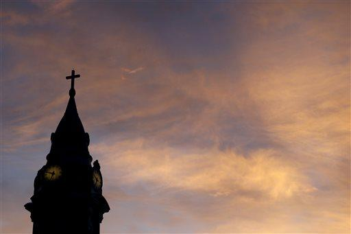 Clouds are lit by the rising sun over St. Augustine Roman Catholic Church in Philadelphia. Recently, a list of Erie-area priests and lay people accused of inappropriate behavior or sexual abuse was released.