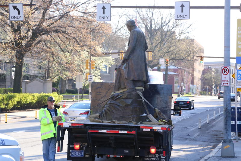 Public Works crews take the Stephen Foster statue away on a flatbed truck after removing it from Schenley Plaza on Thursday, April 26, 2018.