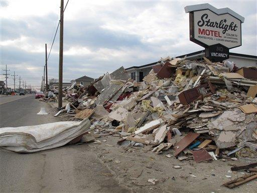 In this Jan. 4, 2012 file photo, huge piles of debris still line portions of Route 35, the main highway through the shore in Toms River N.J. after Hurricane Sandy.