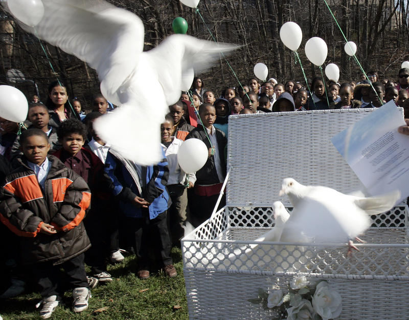 Students watch as four doves are released Monday, April 10, 2006 in Cleveland Heights, Ohio for Aleyshia Hayes who was killed in a fire. A new study found a substantial racial disparity in suicides for children five through 12.