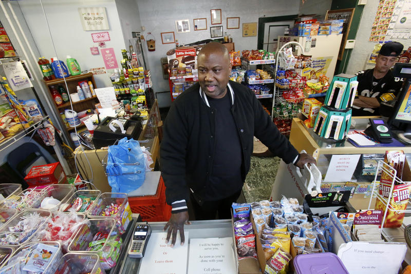 In this Feb. 26, 2018, file photo, Carl Lewis in his market in Rankin, Pa. About half of Lewis' customers pay with benefits from the federal Supplemental Nutrition Assistance Program.