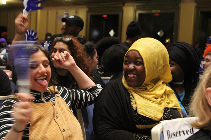 Despina Xanakis, left, and Khadija Abdalla, right, celebrate Thursday at Signing Day.