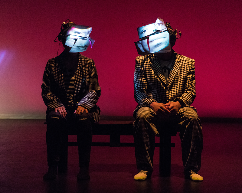 "Performers wear video masks in Bill Shannon's dance work ""Touch Update"""