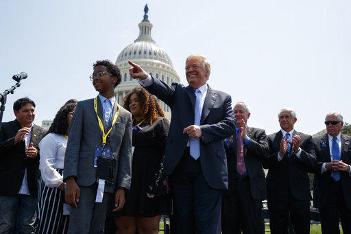 President Donald Trump points to the crowd during the 37th annual National Peace Officers Memorial Service on Capitol Hill, Tuesday, May 15, 2018, in Washington.