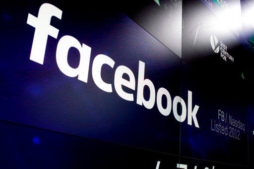 In this March 29, 2018, file photo, the logo for Facebook appears on screens at the Nasdaq MarketSite in New York's Times Square.