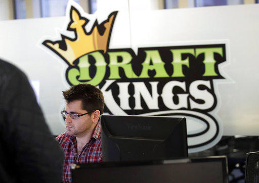 Employees work at the DraftKings office in Boston on Jan. 11, 2018. The explosion in popularity of daily fantasy sports over the last decade has created a generation of sports fans more attuned to gauging player performance.