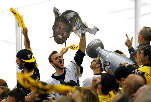 Penguins fans hold signs taunting the Nashville Predators during Game 5 of the 2017 Stanley Cup finals.