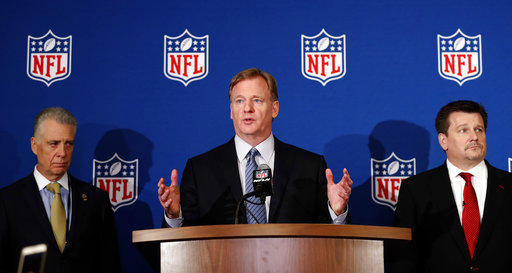 NFL commissioner Roger Goodell, center, is flanked by Pittsburgh Steelers president Art Rooney II, left, and Arizona Cardinals owner Michael Bidwill during a news conference where he announced that NFL team owners have reached agreement on a new policy.
