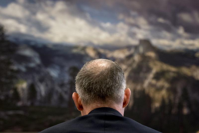 An image of Yosemite National Park hangs above EPA head Scott Pruitt as he testifies on Capitol Hill.
