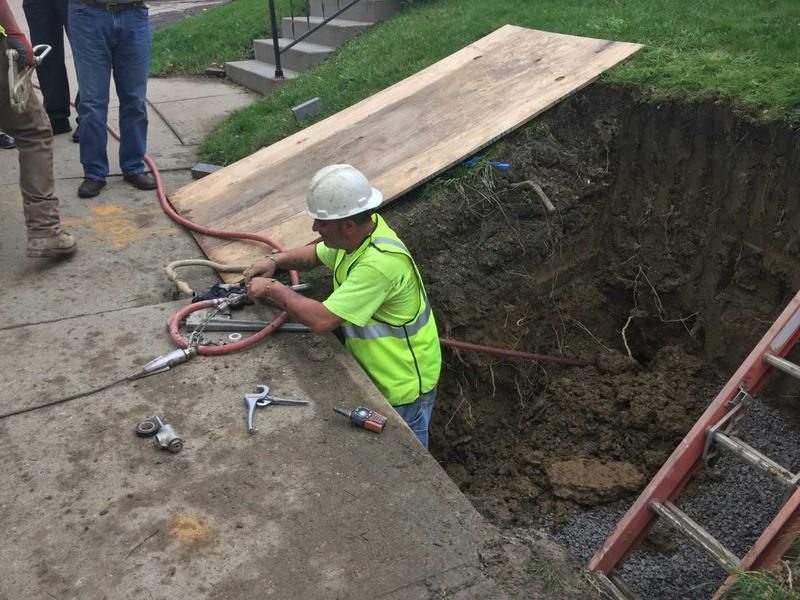 Foreman Joe Bruno prepares the copper replacement pipe on Friday, May 4, 2018.