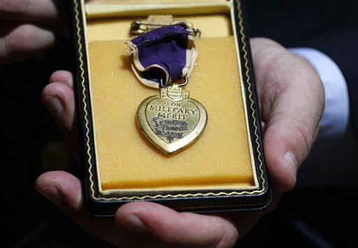 Purple Hearts Reunited founder Capt. Zachariah Fike, who was wounded in Afghanistan while serving with the Vermont Army National Guard, displays a Purple Heart from Pearl Harbor which has yet to be reunited with its owner or relatives in August 2014.