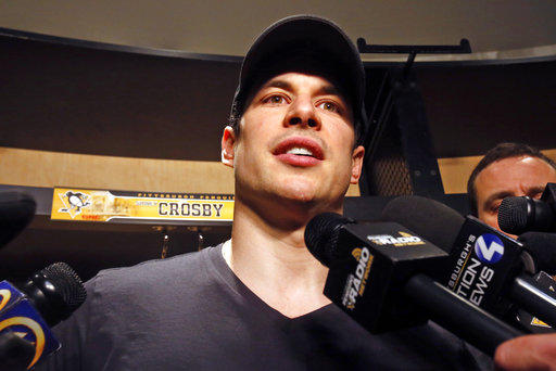 Pittsburgh Penguins' Sidney Crosby talks with media before cleaning out his locker in the NHL hockey team's practice locker room in Cranberry, Pa., Wednesday, May 9, 2018.