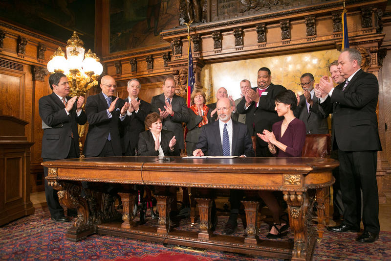 Gov. Tom Wolf signs an executive order to raise minimum wage, calling on the legislature to raise minimum wage statewide on March 7, 2016.