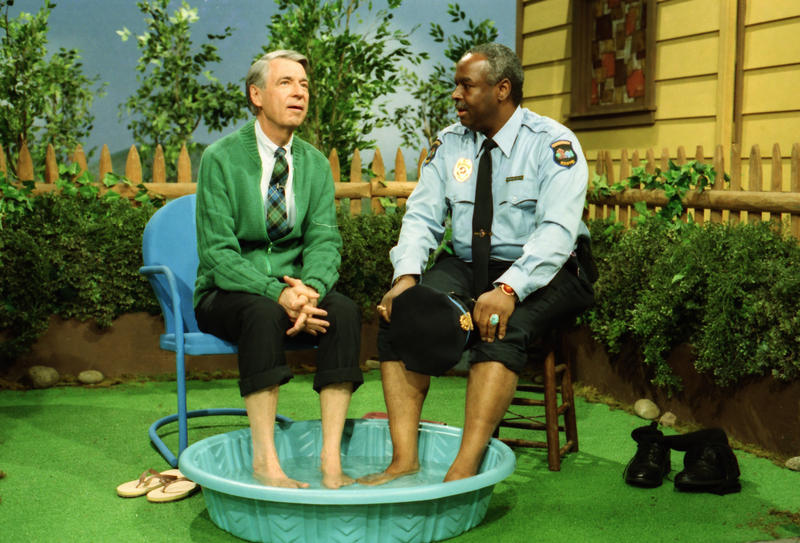 "Fred Rogers and Officer Clemmons (Francois Clemmons) share a wading pool on ""Mr. Rogers' Neighborhood."""