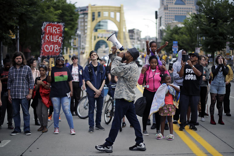 Demonstrators marched through downtown Pittsburgh Friday night, gathering in front of PNC Park to protest the fatal shooting of 17-year-old Antwon Rose Jr.