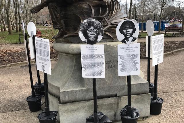 Signs telling the stories of seven prominent African-American women from Pittsburgh history surround the now-removed Stephen Foster statue back in April.