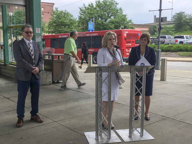 Urban Redevelopment Authority Executive Director Robert Rubinstein (left), Port Authority CEO Katharine Kelleman (center) and Federal Transit Administration Acting Administrator K. Jane Williams (right) discuss the new buses on Wednesday, June 13, 2018.