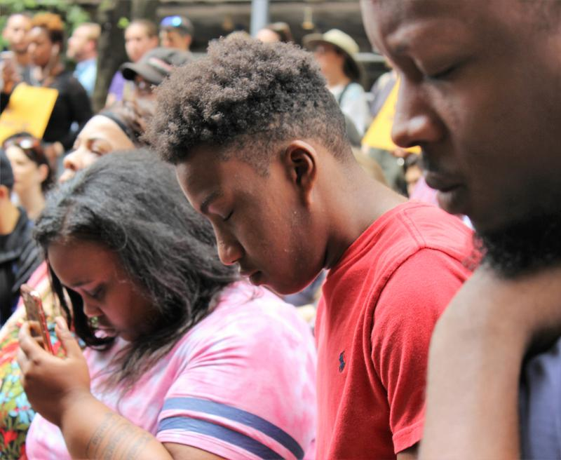 A moment of silence for reflection is held during a protest of the death of Antwon Rose Jr., 17, who was fatally shot by an East Pittsburgh police officer on Tuesday, June 19, 2018.