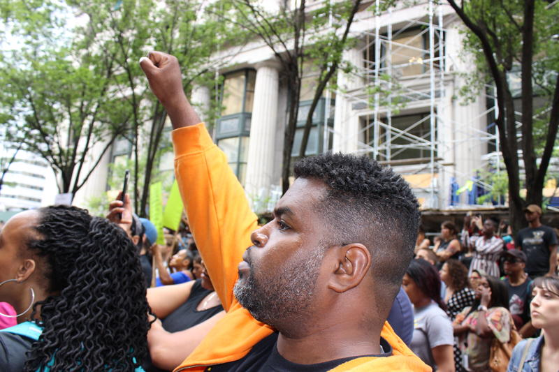 David Tuliaferro Jr. raising his hand in solidarity with protesters at the rally for Antwon Rose Jr. on Thursday, June 21, 2018.