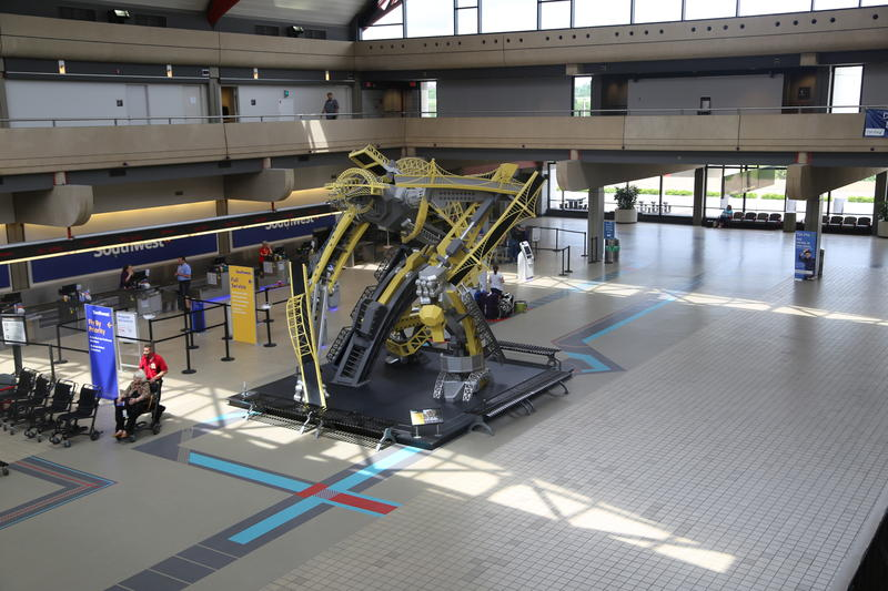 """Arch"" the robot/bridge creature/transformer-type structure greets visitors on the landside terminal area of Pittsburgh International Airport. The art, created by Glenn Kaino in 2008, is one of many exhibits at PIT that exemplify elements of the city."