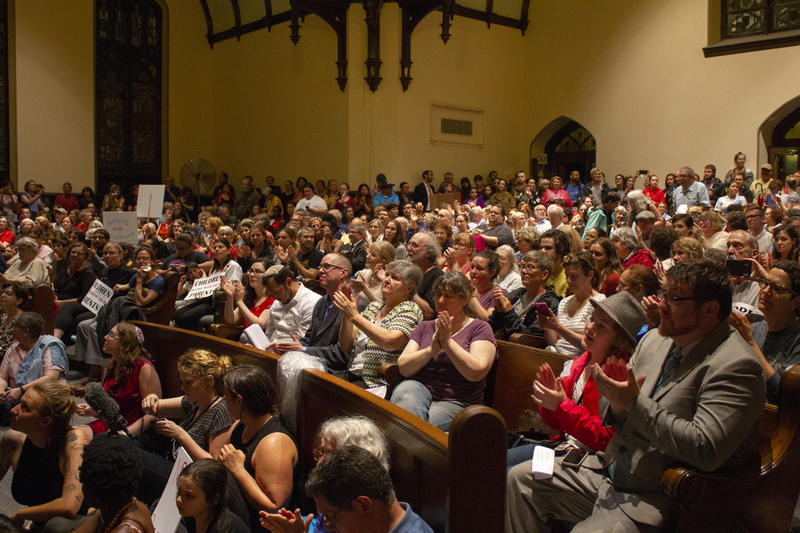 "Protesters fill Sixth Presbyterian Church in Squirrel Hill on Wednesday, June 20, 2018, to decry the Trump Administration's ""zero tolerance"" border policy."