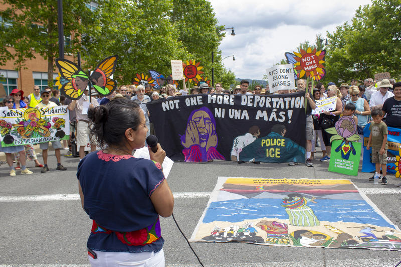 Monica Ruiz, a community organizer with Casa San Jose, speaks to demonstrators.