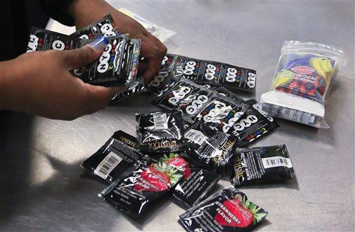 An outreach worker at Boom Health Center packs condoms for distribution to sex workers in the Bronx. Then-Mayor Bill de Blasio declared in 2014 that NYC police would no longer confiscate unused condoms as evidence or instruments of crime.