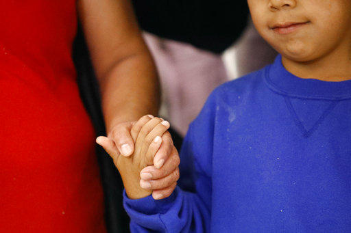 Darwin Micheal Mejia, right, holds hands with his mother Beata Mariana de Jesus Mejia-Mejia, during a news conference following their reunion at Baltimore-Washington International Thurgood Marshall Airport, Friday, June 22, 2018.