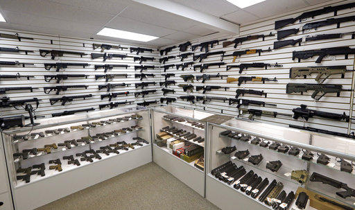 Dozens of semi-automatic rifles line a pair of walls in a gun shop Tuesday, Nov. 7, 2017 in Lynnwood, Wash. Pennsylvania lawmakers are advancing legislation to more aggressively take firearms from those with a domestic violence PFA against them.