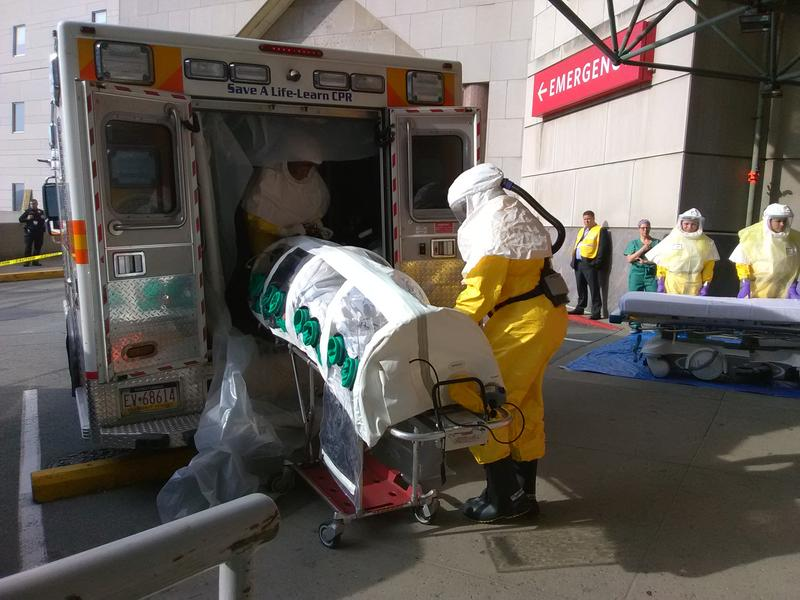 EMTs unload Parag S. Gohel from an ambulance at UPMC Presbyterian's ER. Gohel is in an isolation pod because he's pretending to have an infectious disease for the hospital's yearly drill. (06/07/2018)