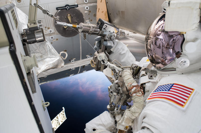 Astronaut Drew Feustel is pictured outside of the International Space Station during a spacewalk to swap thermal control gear.