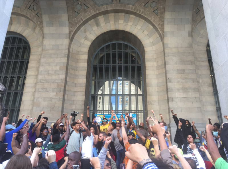 Protesters gather outside of the City-County Building downtown on Tuesday, June 26, 2018.