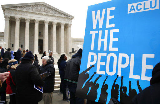 In this Jan. 10, 2018 file photo, people rally outside of the Supreme Court in opposition of Ohio's voter roll purges in Washington.