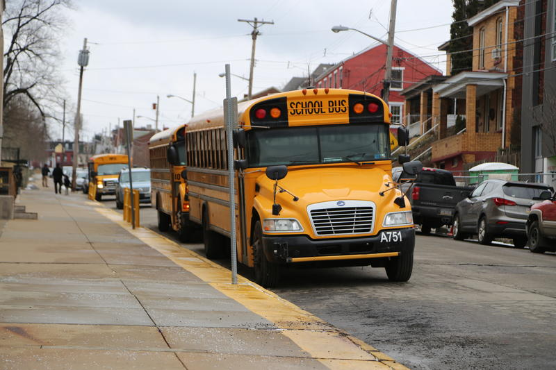 Buses line up outside of Arsenal Middle School in Pittsburgh's Lawrenceville neighborhood.