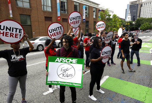 Union activists stand in the road as they participate in a protest by the Philadelphia Council AFL-CIO Wednesday, June 27, 2018 in Philadelphia following a recent U.S. Supreme Court ruling.