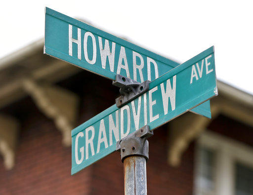 Street signs mark the intersection of Howard and Grandview avenues on Wednesday, June 20, 2018, near where witnesses say a police officer fatally shot a 17-year-old boy just seconds after he fled from a traffic stop in a confrontations in East Pittsburgh.