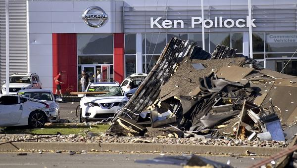 Debris and damaged vehicles sit in front of a car dealership on Thursday, June 14, 2018 in Wilkes-Barre Township, Pa.