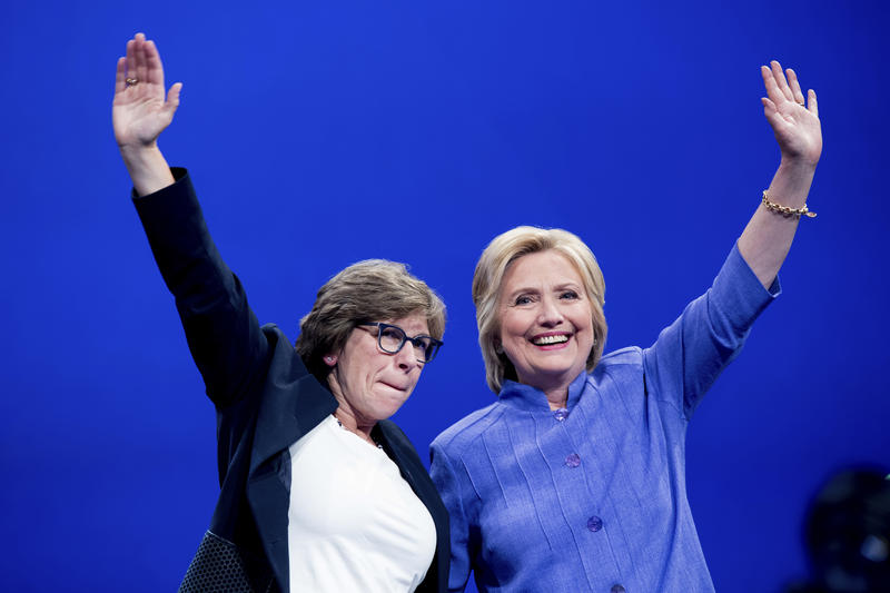 Democratic presidential candidate Hillary Clinton waves with AFT President Randi Weingarten, left, after speaking at the American Federation of Teachers convention at the Minneapolis Convention Center in Minneapolis, Monday, July 18, 2016.