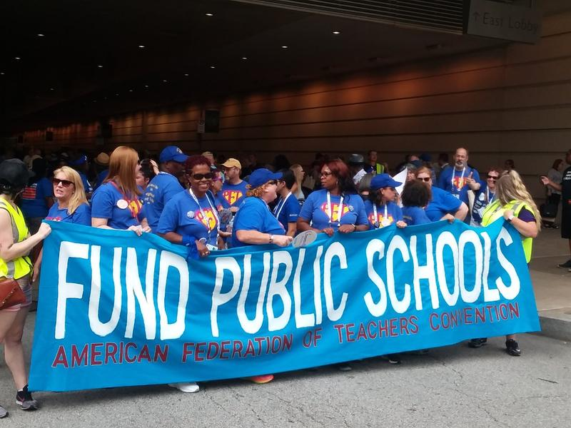 Demonstrators from the American Federation of Teacher prepare to march through downtown Pittsburgh on Saturday, July 14, 2018.
