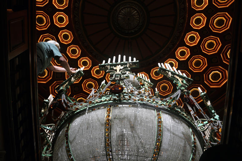 Workers clean the delicate candlesticks and crystals of the large Benedum Center chandelier on Tuesday, June 5, 2018.